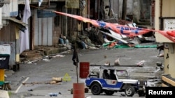 A view of the Maute group stronghold with an ISIS flag in Marawi City in southern Philippines May 29, 2017.