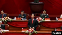 FILE - Vietnam's Prime Minister Nguyen Tan Dung (C, bottom) speaks during the opening ceremony of the 12th National Congress of Vietnam's Communist Party in Hanoi, Vietnam, Jan. 21, 2016.