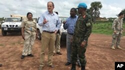 David Shearer, second left, the United Nations peacekeeping mission chief in South Sudan, visits the troubled region of Yei, South Sudan, July 13. 2017. Shearer says he's considering putting a permanent U.N. presence in the town, but only if the government grants unrestricted access.