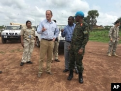 FILE - David Shearer, second left, the United Nations peacekeeping mission chief in South Sudan, visits the troubled region of Yei, South Sudan, July 13, 2017.