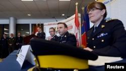 RCMP Chief Superintendent Jennifer Strachan (R), Assistant Commissioner James Malizia (C) and Chief Superintendent Gaeten Courchesne (L) speak during a news conference in Toronto, Ontario, April 22, 2013.