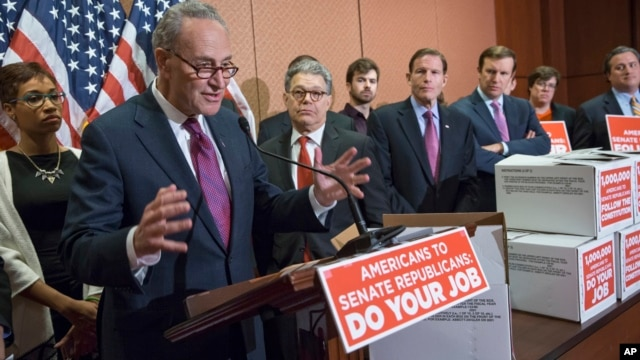 From left, Sen. Charles Schumer, D-N.Y., Sen. Al Franken, D-Minn., Sen. Richard Blumenthal, D-Conn., and Sen. Chris Murphy, D-Conn., talk to reporters on Capitol Hill in Washington about Senate Republicans' refusal to act on any Supreme Court nomination.