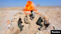 16일 이라크 중부 나자프에서 '이슬람국가'(ISIL)에 대항하기 위해 정부군에 지원한 수니파 군인들이 훈련을 받고 있다.