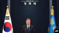 FILE - South Korea's new President Moon Jae-In speaks at the presidential Blue House in Seoul.