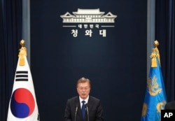 South Korea's new President Moon Jae-In speaks at the presidential Blue House in Seoul.