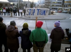 People gather in front of the Alaska Capitol on Jan. 30, 2017, in Juneau, Alaska, to protest President Donald Trump's executive order affecting immigration and refugees.