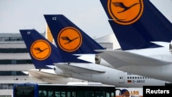 FILE - Lufthansa aircrafts sit on the tarmac at Frankfurt airport, July 12, 2013.