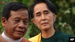 Leader of the National League for Democracy (NLD) party Aung San Suu Kyi, right arrives to participate in a gathering with newly elected lawmakers of NLD on Thursday, March 10, 2016 in Naypyitaw, Myanmar.