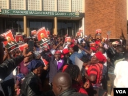 Some of the people who protested outside the Harare Magistrates' Courts following delays in bringing Job Sikhala to court.