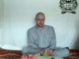 This video frame grab taken from a Taliban propaganda video released Saturday, July 18, 2009 shows Bowe Bergdahl, who disappeared June 30, 2009.
