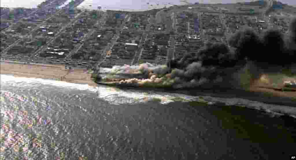 This frame grab from video provided by Fox 29 shows a raging fire in Seaside Park, New Jersey, Sept. 12, 2013.