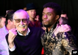 "FILE - Comic book legend Stan Lee, left, creator of the ""Black Panther"" superhero, poses with Chadwick Boseman, star of the new ""Black Panther"" film, at the premiere at The Dolby Theatre in Los Angeles, Jan. 29, 2018."
