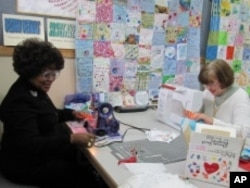 Local quilters volunteered to sew thousands of patches together into a huge quilt.