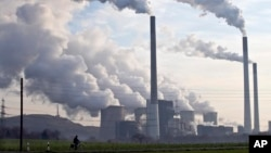 FILE - Coal burning power plants are the biggest source of carbon pollution, which is responsible for climate change.