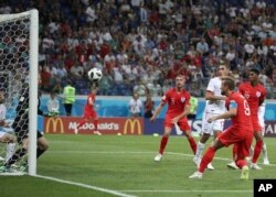 England's Harry Kane scores during the group G match between Tunisia and England at the 2018 soccer World Cup in the Volgograd Arena in Volgograd, Russia, Monday, June 18, 2018.