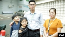 FILE - Former Radio Free Asia reporters Yeang Sothearin and his family pose for picture outside Phnom Penh Municipal Court Friday, August 30, 2019. (Tum Malis/VOA Khmer)