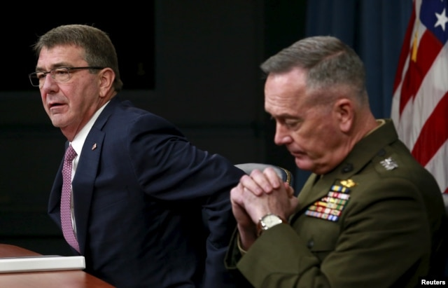 "U.S. Defense Secretary Ash Carter, left, and Joint Chiefs Chairman Marine Gen. Joseph Dunford speak at the Pentagon in Washington, Feb. 29, 2016. Carter said the Syrian cease-fire, if ""properly adhered to,"" could lead to a decline in violence."