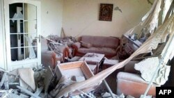 Một căn nhà ở Baba Amr, khu vực phụ cận thành phố Homs, bị phá hủy vì đạn pháo của lực lượng chính phủ Syria