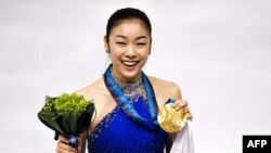 Nhà vô địch trượt băng nghệ thuật Kim Yu Na đại diện cho Nam Triều Tiên