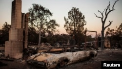 A view shows a house and vehicle destroyed by the Clover Fire in Happy Valley, California, Sept. 10, 2013.