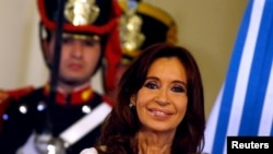 FILE - Former Argentine President Cristina Fernandez smiles during a ceremony on her last day in office at the Casa Rosada Presidential Palace in Buenos Aires, Argentina, Dec. 9, 2015.