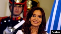 FILE - Argentina's President Cristina Fernandez de Kirchner smiles during a ceremony on her last day in office at the Casa Rosada Presidential Palace in Buenos Aires, Argentina, Dec. 9, 2015.