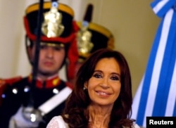Argentina's President Cristina Fernandez de Kirchner smiles during a ceremony on her last day in office at the Casa Rosada Presidential Palace in Buenos Aires, Dec. 9, 2015.