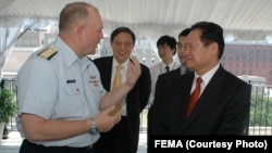 FILE - U.S. Admiral Thad Allen speaks with former Chinese Minister of Public Security Zhou Yongkang in 2006.