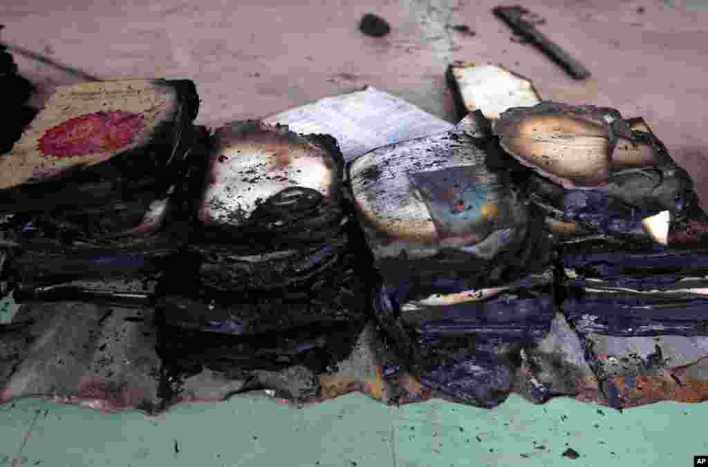 The remains of burned religious books at a Buddhist temple that was torched in an overnight attack in Ramu in the coastal district of Cox's Bazar, Bangladesh, October 1, 2012.