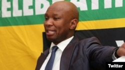 """FILE - African National Congress spokesman Zizi Kodwa is seen delivering a speech in a photo taken from his Twitter feed @zizikodwa. Kodwa has accused the U.S. of trying to """"undermine the democratically elected government"""" of South Africa."""