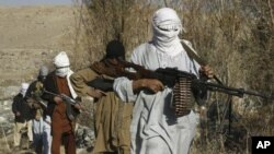Taliban fighters pose with weapons in an undisclosed location in Nangarhar province (file photo)