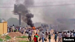 People take part in protests over fuel subsidy cuts in Khartoum September 25, 2013. At least 27 people have been killed in protests in Khartoum over fuel subsidy cuts, a medical source said on Thursday as another bout of the worst unrest seen in Sudan's r