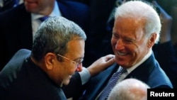 Israeli Defence Minister Ehud Barak and U.S. Vice President Joe Biden (R) meet at the 49th Conference on Security Policy in Munich, February 2, 2013.