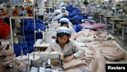 FILE - North Korean employees sew in a South Korean-owned company at the Kaesong industrial park. North Korea has lifted a ban that had kept two South Korean officials from entering a factory complex.