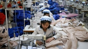FILE - North Korean employees, shown in December 2013, sew in a South Korean-owned company at the Kaesong industrial park just north of the demilitarized zone.