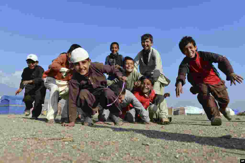 Afghan children play on the outskirts of Jalalabad, capital of Nangarhar province, Dec. 13, 2016.