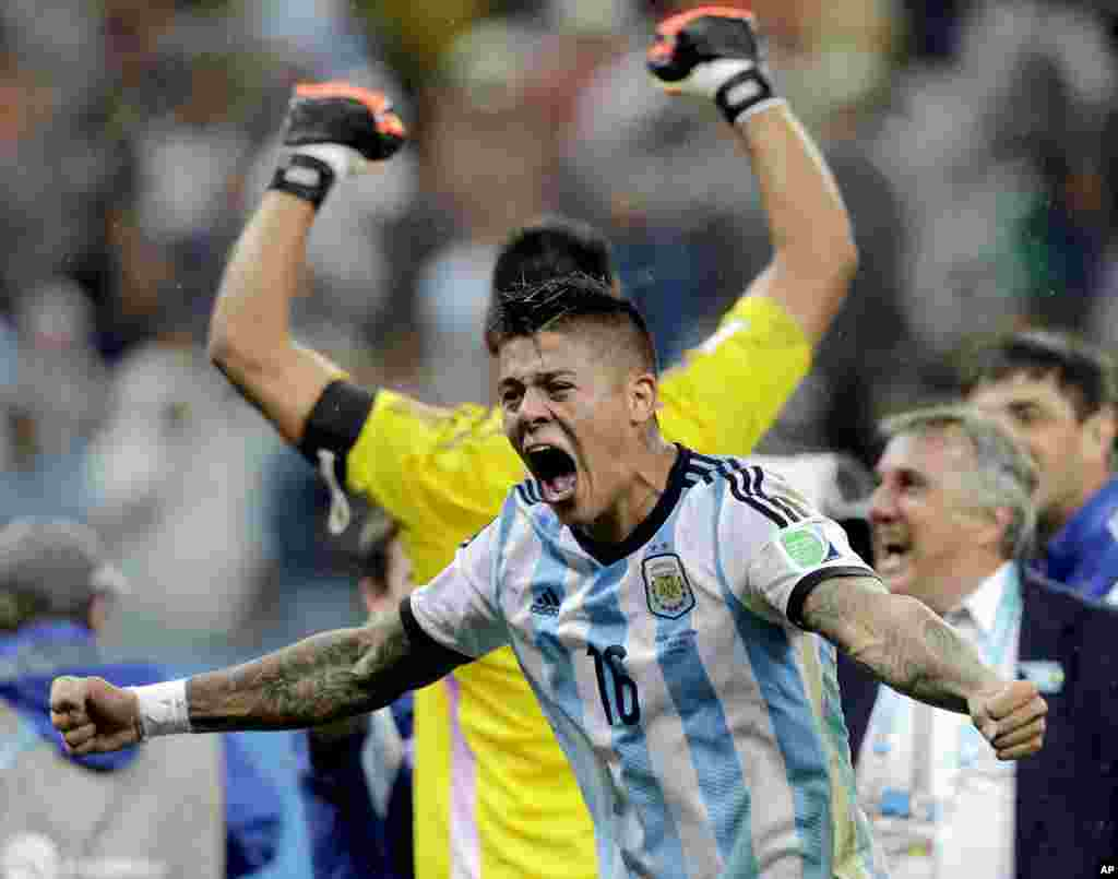 Argentina's Marcos Rojo celebrates after Argentina defeated the Netherlands 4-2 in a penalty shootout after a 0-0 tie after extra time to advance to the finals during the World Cup, July 9, 2014.