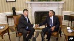 President Barack Obama shakes hands with Georgian President Mikhail Saakashvili at the White House Jan., 30, 2012.