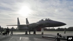 FILE - An F-15E Strike Eagle sits on the flightline at Royal Air Force Lakenheath, England, in October 2010.