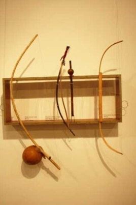Musical bows, including a Xhosa uhadi (left), on display at an International Library of African Music exhibition in South Africa