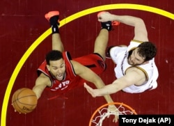 Toronto Raptors' Cory Joseph (6) shoots against Cleveland Cavaliers' Kevin Love (0) during the second half of Game 2 of the NBA basketball Eastern Conference finals Thursday, May 19, 2016, in Cleveland. The Cavaliers won 108-89.