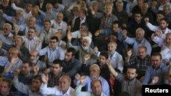FILE - Iranian worshippers chant slogans against Bahraini regime and Saudi Arabia during Friday prayers in Tehran, Iran, May 26, 2017.