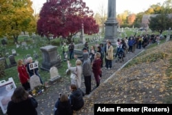 People line up to visit the grave of women's suffrage leader Susan B. Anthony on U.S. election day at Mount Hope Cemetery in Rochester, New York November 8, 2016.