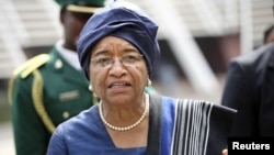Liberia's President Ellen Johnson Sirleaf disputes claims of a member of parliament regarding amounts paid to U.S. lobbying firms.