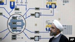 FILE - President Hassan Rouhani visits the Bushehr nuclear power plant just outside the port city of Bushehr, Iran, Jan. 13, 2015, in this photo released by the Iranian Presidency Office.