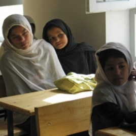 Afghan girls attend their first day of class at a school in the village of Deh Hassan.