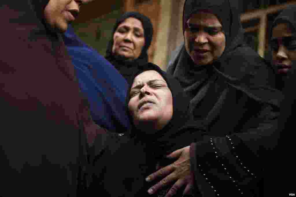 A Muslim mother grieves her son, who was killed during a terror attack on a church as he was passing by, in Cairo, Egypt. Terror attacks against Copts increase during the new year holidays. (H. Elrasam/VOA)