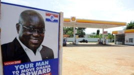 A poster of the presidential candidate of the opposition New Patriotic Party counterpart Nana Akufo-Addo is seen at the entrance of a gasoline station in Accra, October 23, 2012