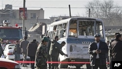 A damaged minibus is seen at the scene after it was attacked by a suicide attacker in Kabul, Afghanistan, 12 Jan 2011
