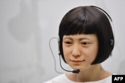 A robot produced by Japan's Hiroshi Ishiguro Laboratories called 'Kodomoroid' Japan 2014 is on view at the ROBOT exhibition at the Science Museum in London on February 7, 2017.